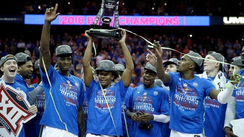 <p>               FILE - In this March 10, 2018, file photo, Kansas players celebrate after winning the Big 12 NCAA college basketball championship game against West Virginia, in Kansas City, Mo. With a bunch of transfers becoming eligible and a bevy of five-star freshmen, Kansas begins pursuit of another Big 12 title _ and perhaps more.  (AP Photo/Charlie Riedel, File)             </p>