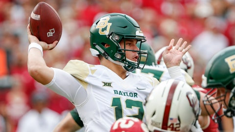 <p>               FILE- In this Sept. 29, 2018, file photo, Baylor quarterback Charlie Brewer (12) passes the ball against Oklahoma in the first half of an NCAA college football game in Norman, Okla. Texas quarterback Sam Ehlinger and Baylor's Charlie Brewer were high school rivals in Austin. The pair face off on Saturday.  (AP Photo/Alonzo Adams, File)             </p>