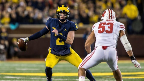 <p>               FILE - In this Oct. 13, 2018, file photo, Michigan quarterback Shea Patterson (2) tries to scramble away from Wisconsin inside linebacker T.J. Edwards (53) in the second quarter of an NCAA college football game, in Ann Arbor, Mich. No. 6 Michigan is preparing to play No. 24 Michigan State with dual-threat quarterback Shea Patterson working on the split-second decisions he makes, choosing when to pass, run or throw the ball away. (AP Photo/Tony Ding, File)             </p>