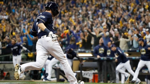<p>               Milwaukee Brewers' Christian Yelich scored the game-winning run during the 10th inning of Game 1 of the National League Divisional Series baseball game against the Colorado Rockies Thursday, Oct. 4, 2018, in Milwaukee. The Brewers won 3-2 to take a 1-0 lead in the series. (AP Photo/Jeff Roberson)             </p>