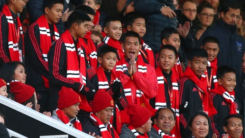 <p>               The 12 boys who were trapped with their soccer coach in a flooded cave in northern Thailand for almost three weeks earlier this year look from the stands before the English Premier League soccer match between Manchester United and Everton FC at Old Trafford in Manchester, England, Sunday Oct. 28, 2018. (AP Photo/Dave Thompson)             </p>