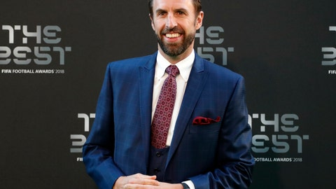 <p>               FILE - In this Monday, Sept. 24, 2018 file photo, England soccer team coach Gareth Southgate arrives for the ceremony of the Best FIFA Football Awards in the Royal Festival Hall in London, Britain. England coach Gareth Southgate has signed a new contract that will keep him in charge of the national team through to the 2022 World Cup in Qatar, it was announced on Thursday, Oct. 4. Southgate, whose deal was due to expire in 2020, has been rewarded for guiding England to the World Cup semifinals in Russia this year. (AP Photo/Frank Augstein, file)             </p>