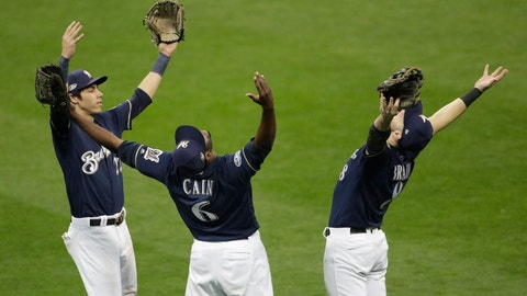 <p>               Milwaukee Brewers' Christian Yelich, Lorenzo Cain and Ryan Braun celebrate after Game 2 of the National League Divisional Series baseball game Friday, Oct. 5, 2018, in Milwaukee.The Brewersb won 4-0 to take a 2-0 lead in the series. (AP Photo/Aaron Gash)             </p>