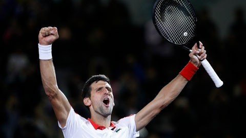 <p>               Novak Djokovic of Serbia celebrates after defeating Borna Coric of Croatia in their men's singles final match in the Shanghai Masters tennis tournament at Qizhong Forest Sports City Tennis Center in Shanghai, China, Sunday, Oct. 14, 2018. (AP Photo/Andy Wong)             </p>