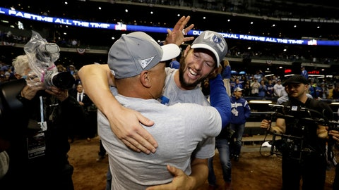 <p>               Los Angeles Dodgers' Clayton Kershaw celebrates with manager Dave Roberts after winning Game 7 of the National League Championship Series baseball game against the Milwaukee Brewers Saturday, Oct. 20, 2018, in Milwaukee. The Dodgers won 5-1. (AP Photo/Matt Slocum)             </p>