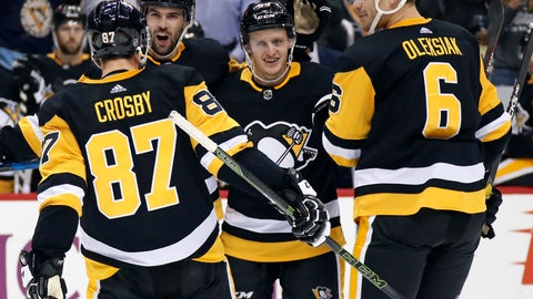 <p>               Pittsburgh Penguins' Jake Guentzel, center, celebrates his goal with Sidney Crosby (87), Justin Schultz (4), and Jamie Oleksiak (6) during the second period of an NHL hockey game against the Washington Capitals in Pittsburgh, Thursday, Oct. 4, 2018. It was Guentzel's second goal of the game. (AP Photo/Gene J. Puskar)             </p>