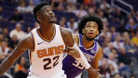 <p>               Phoenix Suns center Deandre Ayton (22) boxes out Sacramento Kings forward Marvin Bagley III, right, during the first half of a preseason NBA basketball game Monday, Oct. 1, 2018, in Phoenix. (AP Photo/Ross D. Franklin)             </p>
