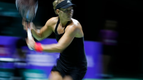 <p>               Angelique Kerber of Germany plays a return while competing against Naomi Osaka of Japan during their women's singles match at the WTA tennis finals in Singapore, Wednesday, Oct. 24, 2018. (AP Photo/Vincent Thian)             </p>