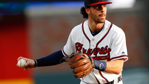 <p>               FILE - In this May 30, 2018, file photo, Atlanta Braves shortstop Dansby Swanson (7) warms up before the first inning of a baseball game against the New York Mets, in Atlanta. The Braves are trying to determine the status of shortstop Dansby Swanson, who has a sore wrist, as they prepare to open their NLDS against the Los Angeles Dodgers .(AP Photo/John Bazemore, File)             </p>