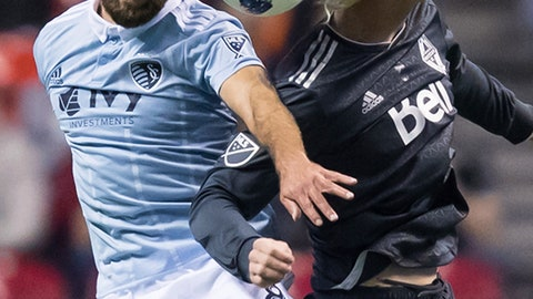 <p>               Sporting Kansas City's Graham Zusi, left, and Vancouver Whitecaps' Brek Shea vie for the ball during the first half of an MLS soccer game in Vancouver, British Columbia, Wednesday, Oct. 17, 2018. (Darryl Dyck/The Canadian Press via AP)             </p>