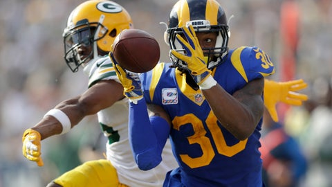 <p>               Los Angeles Rams running back Todd Gurley makes a catch as Green Bay Packers defensive back Jermaine Whitehead defends during the first half of an NFL football game, Sunday, Oct. 28, 2018, in Los Angeles. (AP Photo/Marcio Jose Sanchez)             </p>