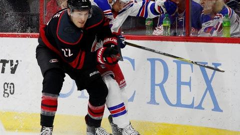 <p>               Carolina Hurricanes' Brett Pesce (22) battles New York Rangers' Ryan Spooner (23) for the puck during the first period of an NHL hockey game, Sunday, Oct. 7, 2018, in Raleigh, N.C. (AP Photo/Karl B DeBlaker)             </p>