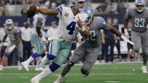 <p>               Dallas Cowboys quarterback Dak Prescott (4) is chased by Detroit Lions linebacker Christian Jones (52) in the second half of an NFL football game in Arlington, Texas, Sunday, Sept. 30, 2018. (AP Photo/Eric Gay)             </p>