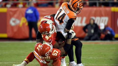 <p>               Kansas City Chiefs linebacker Breeland Speaks (57) and defensive lineman Chris Jones (95) sack Cincinnati Bengals quarterback Andy Dalton (14) during the second half of an NFL football game in Kansas City, Mo., Sunday, Oct. 21, 2018. The Chiefs won, 45-10. (AP Photo/Reed Hoffmann)             </p>