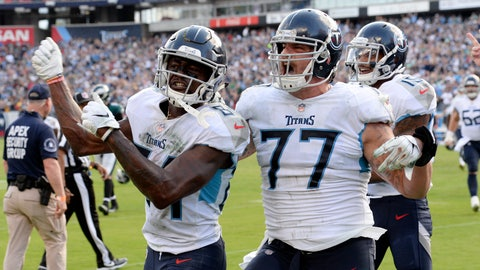 <p>               Tennessee Titans wide receiver Corey Davis (84) celebrates with offensive tackle Taylor Lewan (77) after Davis caught the winning touchdown pass against the Philadelphia Eagles in overtime of an NFL football game Sunday, Sept. 30, 2018, in Nashville, Tenn. The Titans won 26-23. (AP Photo/Mark Zaleski)             </p>