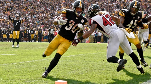<p>               Pittsburgh Steelers running back James Conner (30) takes a handoff from quarterback Ben Roethlisberger (7) and runs it in for a touchdown around Atlanta Falcons linebacker Duke Riley (42) in the second half of an NFL football game against the Pittsburgh Steelers, Sunday, Oct. 7, 2018, in Pittsburgh. (AP Photo/Don Wright)             </p>