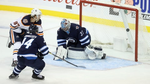 <p>               Edmonton Oilers' Connor McDavid (97) scores on Winnipeg Jets goaltender Connor Hellebuyck (37) with Josh Morrissey (44) trailing during the first period of an NHL hockey game, Tuesday, Oct. 16, 2018 in Winnipeg, Manitoba. (Trevor Hagan/The Canadian Press via AP)             </p>