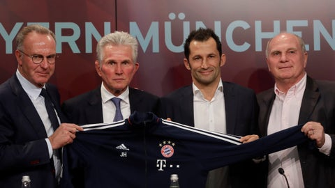 """<p>               FILE - In this Monday, Oct. 9, 2017 file photo, Bayern Munich's new coach Jupp Heynckes, second left, is flanked by the club's CEO Karl-Heinz Rummenigge, left, president Uli Hoeness, right, and sports director Hasan Salihamidzic, second right, during his presentation at a news conference in Munich, Germany. German soccer giant Bayern Munich has hit out against the media for what it calls """"derogatory, slanderous reporting"""" of the club's recent struggles _ and even threatened to take legal action. Bayern's chairman Karl-Heinz Rummenigge, president Uli Hoeness and sport director Hasan Salihamidzic appeared at a joint press conference on Friday, Oct. 19, 2018 speaking out against what they deem to be unfavorable coverage after four games without a win. (AP Photo/Matthias Schrader, file)             </p>"""