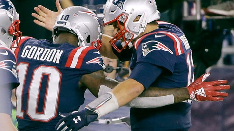 <p>               New England Patriots quarterback Tom Brady, right, celebrates his touchdown pass to wide receiver Josh Gordon (10) during the second half of an NFL football game against the Indianapolis Colts, Thursday, Oct. 4, 2018, in Foxborough, Mass. (AP Photo/Steven Senne)             </p>