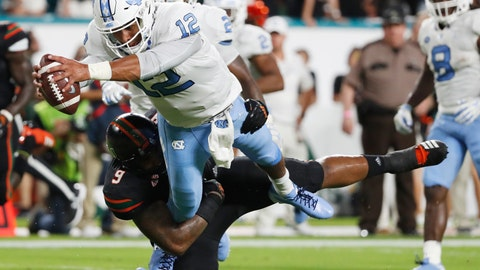 <p>               FILE - In this Sept. 27, 2018, file photo, North Carolina quarterback Chazz Surratt (12) dives in for a touchdown as he is tackled by Miami defensive lineman Gerald Willis III (9) during the first half of an NCAA college football game in Miami Gardens, Fla. Willis is second in the nation in tackles for loss with 12.5. (AP Photo/Wilfredo Lee, File)             </p>