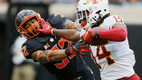 <p>               Iowa State wide receiver Tarique Milton (14) fights off a tackle by Oklahoma State cornerback Kris McCune (32) in the second half of an NCAA college football game in Stillwater, Okla., Saturday, Oct. 6, 2018. (AP Photo/Sue Ogrocki)             </p>