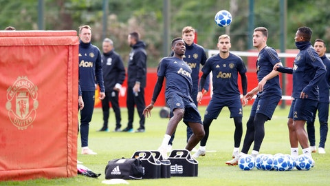 <p>               Manchester United's Paul Pogba, center, attends a training session at the AON Training Complex, Carrington, north west England, Monday Oct. 1, 2018. (Martin Rickett/PA via AP)             </p>