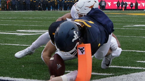 <p>               FILE - In this Saturday, Nov. 18, 2017 file photo, Texas defensive back Brandon Jones (19) tackles West Virginia quarterback Will Grier (7) short of the goal line during the first half of an NCAA college football game in Morgantown, W.Va. Grier injured his hand in during the play and left the game. Grier says he won't use a season-ending injury he suffered last season against Texas as additional motivation when No. 12 West Virginia plays the 15th-ranked Longhorns on Saturday, Nov. 3, 2018 in Austin, Texas.  (AP Photo/Raymond Thompson, File)             </p>