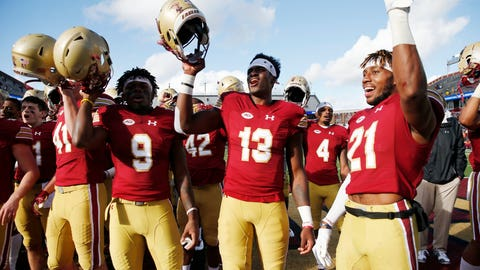 <p>               Boston College quarterback Anthony Brown (13), wide receiver Kobay White (9) and defensive back Lukas Denis (21) celebrate after defeating Louisville during an NCAA college football game in Boston, Saturday, Oct. 13, 2018. (AP Photo/Michael Dwyer)             </p>