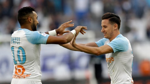 <p>               Marseille's Florian Thauvin, right, celebrates with teammate Dimitri Payet after scoring his side's second goal during the League One soccer match between Marseille and Caen at the Velodrome stadium, in Marseille, southern France, Sunday, Oct. 7, 2018. (AP Photo/Claude Paris)             </p>