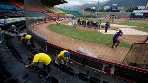 <p>               In this Oct. 12, 2018 photo, workers clean the VIP seating area prior to the baseball season's opening game between Leones de Caracas and Tiburones de la Guaira in Caracas, Venezuela. Ramon Guillermo Aveledo, a former Venezuela baseball league president and prominent opposition leader, said he applauds the government's decision to spend its dwindling supply of dollars on baseball while acknowledging there are more pressing needs. (AP Photo/Fernando Llano)             </p>