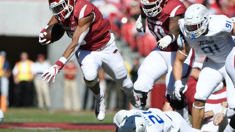 <p>               Arkansas running back Rakeem Boyd, top, gets past Tulsa defender Bryson Powers as he runs the ball in the first half of an NCAA college football game Saturday, Oct. 20, 2018, in Fayetteville, Ark. (AP Photo/Michael Woods)             </p>