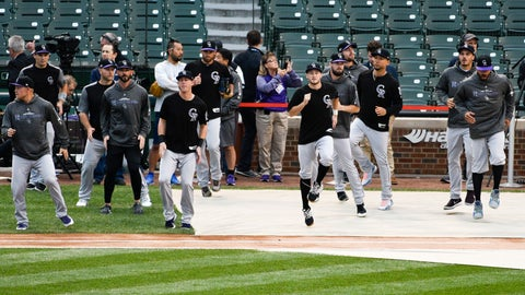 <p>               The Colorado Rockies warm up before a National League wild-card playoff baseball game against the Chicago Cubs, Tuesday, Oct. 2, 2018, in Chicago. (AP Photo/David Banks)             </p>