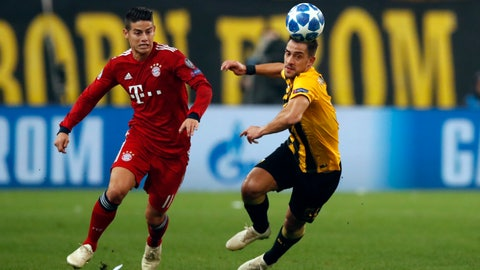 <p>               AEK's Vasileios Lampropoulos, right, vie for the ball Bayern midfielder James David James Rodriguez during a Group E Champions League soccer match between AEK Athens and Bayern Munich at the Olympic Stadium in Athens, Tuesday, Oct. 23, 2018. (AP Photo/Thanassis Stavrakis)             </p>