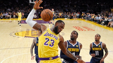 <p>               FILE - In this Tuesday, Oct. 2, 2018, file photo, Los Angeles Lakers forward LeBron James, left, dunks as Denver Nuggets forward Paul Millsap, center, and guard Monte Morris watch during the first half of an NBA basketball game in Los Angeles. James says he didn't choose the Lakers as his free-agent destination because of his burgeoning career as a Hollywood producer and performer. He remains focused on basketball, and he wants to create a winning team to end the Lakers' franchise-record five years without a playoff berth. (AP Photo/Mark J. Terrill, File)             </p>