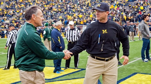 <p>               FILE - In this Oct. 17, 2015, file photo, Michigan State head coach Mark Dantonio shakes hands with Michigan head coach Jim Harbaugh on the Michigan Stadium field before an NCAA college football game in Ann Arbor, Mich. Sixth-ranked Michigan has won six straight and is in the top 10 for the first time this season. The Wolverines need to beat rival Michigan State this Saturday to keep the roll going.  (AP Photo/Tony Ding, FIle)             </p>