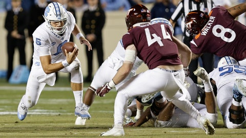 <p>               North Carolina quarterback Cade Fortin (6) runs the ball while Virginia Tech's Dylan Rivers (44) looks to tackle him during the first half of an NCAA college football game in Chapel Hill, N.C., Saturday, Oct. 13, 2018. (AP Photo/Gerry Broome)             </p>