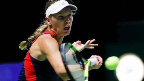<p>               Caroline Wozniacki of Denmark plays a return shot while competing against Elina Svitolina of the Ukraine during their women's singles match at the WTA tennis finals in Singapore, Thursday, Oct. 25, 2018. (AP Photo/Vincent Thian)             </p>