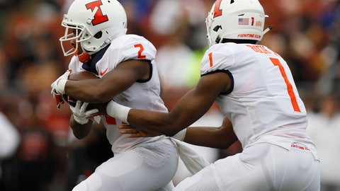 <p>               Illinois quarterback AJ Bush Jr., right, hands off to running back Reggie Corbin, who ran for a touchdown on the play during the first half of an NCAA college football game against Rutgers, Saturday, Oct. 6, 2018, in Piscataway, N.J. (AP Photo/David Boe)             </p>