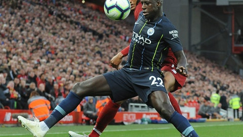 <p>               Manchester City's Benjamin Mendy, front, and Liverpool's Joe Gomez vie for the ball during the English Premier League soccer match between Liverpool and Manchester City at Anfield stadium in Liverpool, England, Sunday, Oct. 7, 2018. (AP Photo/Rui Vieira)             </p>