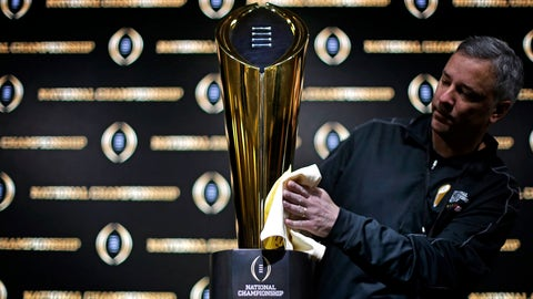 <p>               FILE - In this Jan. 7, 2018 file photo Charley Green buffs the NCAA college football championship trophy before a coaches news conference in Atlanta. The College Football Playoff selection committee begins its fifth season Tuesday, Oct. 30, 2018 of presenting weekly rankings and if form holds two schools in the first top four will go on to play in the semifinals. The usefulness of the committee's work and the nationally televised reveal is debatable. But what if anything can be learned from the first four years of CFP rankings? Of the 16 teams the committee ranked in the top four of its initial rankings from 2014-17, half made the playoff. (AP Photo/David Goldman, file)             </p>