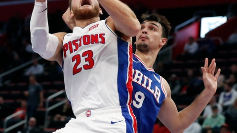 <p>               Detroit Pistons forward Blake Griffin (23) shoots as Philadelphia 76ers forward Dario Saric (9) defends during the first half of an NBA basketball game, Tuesday, Oct. 23, 2018, in Detroit. (AP Photo/Carlos Osorio)             </p>