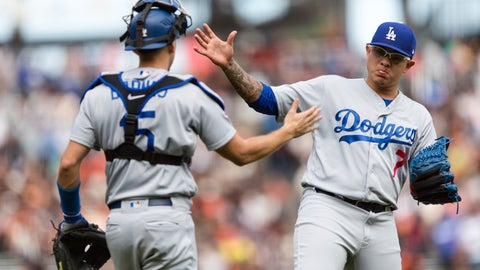 <p>               Los Angeles Dodgers catcher Austin Barnes, left, and relief pitcher Julio Urias celebrate defeating the San Francisco Giants in a baseball game in San Francisco, Sunday, Sept. 30, 2018. (AP Photo/John Hefti)             </p>