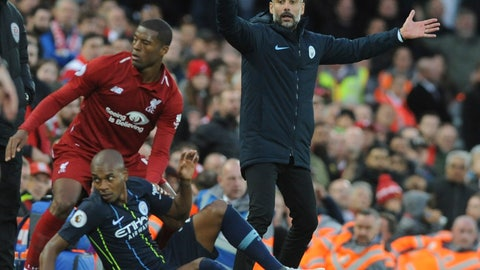 <p>               Manchester City manager Josep Guardiola appeals for a foul after Liverpool's Georginio Wijnaldum, standing, and Manchester City's Fernandinho, sitting, collided during the English Premier League soccer match between Liverpool and Manchester City at Anfield stadium in Liverpool, England, Sunday, Oct. 7, 2018. (AP Photo/Rui Vieira)             </p>