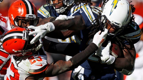 <p>               Cleveland Browns defensive back Damarious Randall (23) attempts to tackle Los Angeles Chargers running back Melvin Gordon (28) in the second half during an NFL football game, Sunday, Oct. 14, 2018, in Cleveland. (AP Photo/Ron Schwane)             </p>