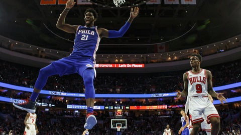 <p>               Philadelphia 76ers Joel Embiid, left, of Cameroon, reacts to his dunk as Chicago Bulls Antonio Blakeney, right, looks on during the first half of an NBA basketball game, Thursday, Oct. 18, 2018, in Philadelphia. (AP Photo/Chris Szagola)             </p>