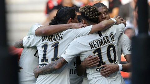 <p>               Paris Saint Germain's Neymar, back, celebrates with Paris Saint Germain's Angel Di Maria, left, and Paris Saint Germain's Kylian Mbappe, after scoring his side's first goal, during the League One soccer match between Nice and Paris Saint-Germain at the Allianz Riviera stadium in Nice, southern France, Saturday, Sept. 29, 2018. (AP Photo/Claude Paris)             </p>
