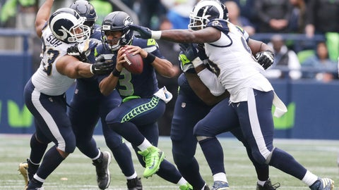 <p>               Los Angeles Rams defensive tackle Ndamukong Suh, left, moves in to sack Seattle Seahawks quarterback Russell Wilson (3) as Rams' Michael Brockers, right, looks on during the second half of an NFL football game, Sunday, Oct. 7, 2018, in Seattle. The Rams won 33-31. (AP Photo/Scott Eklund)             </p>