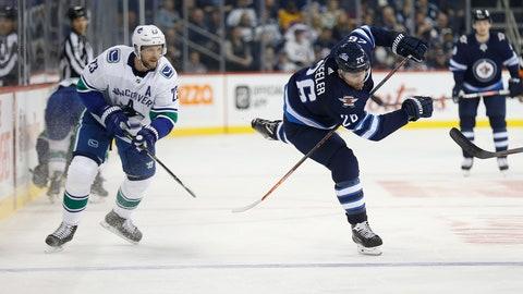<p>               Winnipeg Jets' Blake Wheeler (26) works his way around Vancouver Canucks' Alexander Edler (23) during second period NHL hockey action in Winnipeg, Manitoba, Thursday, Oct. 18, 2018. (John Woods/The Canadian Press via AP)             </p>