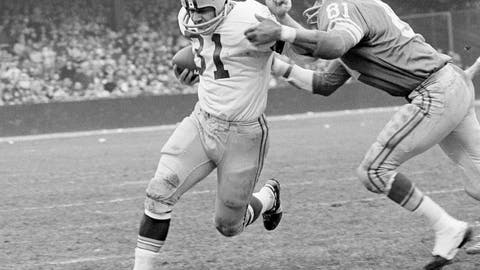 <p>               FILE - In this Nov. 22, 1962, file photo, Green Bay Packers fullback Jim Taylor (31) is brought down by Detroit Lions' Dick Lane in the third quarter of an NFL football game in Detroit. The Hall of Fame fullback died early Saturday, Oct. 13, 2018, the Packers announced. He was 83.  (AP Photo/Preston Stroup, File)             </p>