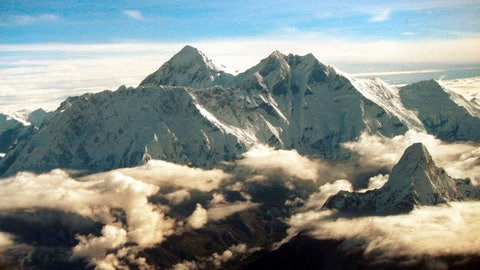 <p>               FILE - In this Aug. 26, 2000, file photo, the southern face of Mount Everest including Mount Lhotse, middle right, soars above the monsoon clouds at the border of Nepal and Tibet. Pemba Sherpa of the Xtreme Climbers Treks and Expeditions says American climbers James Morrison and Hilaree Nelson successfully skied down Mount Lhotse's 8,516-meter (27,940-foot) summit after scaling it on Sunday. (AP Photo/John McConnico, File)             </p>